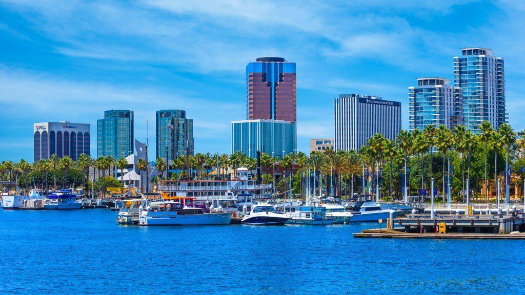 Rainbow Harbor at Long Beach Marina with city skyline, California.