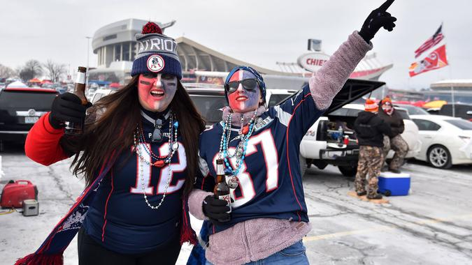Patriots fans tailgate outside Arrowhead Stadium