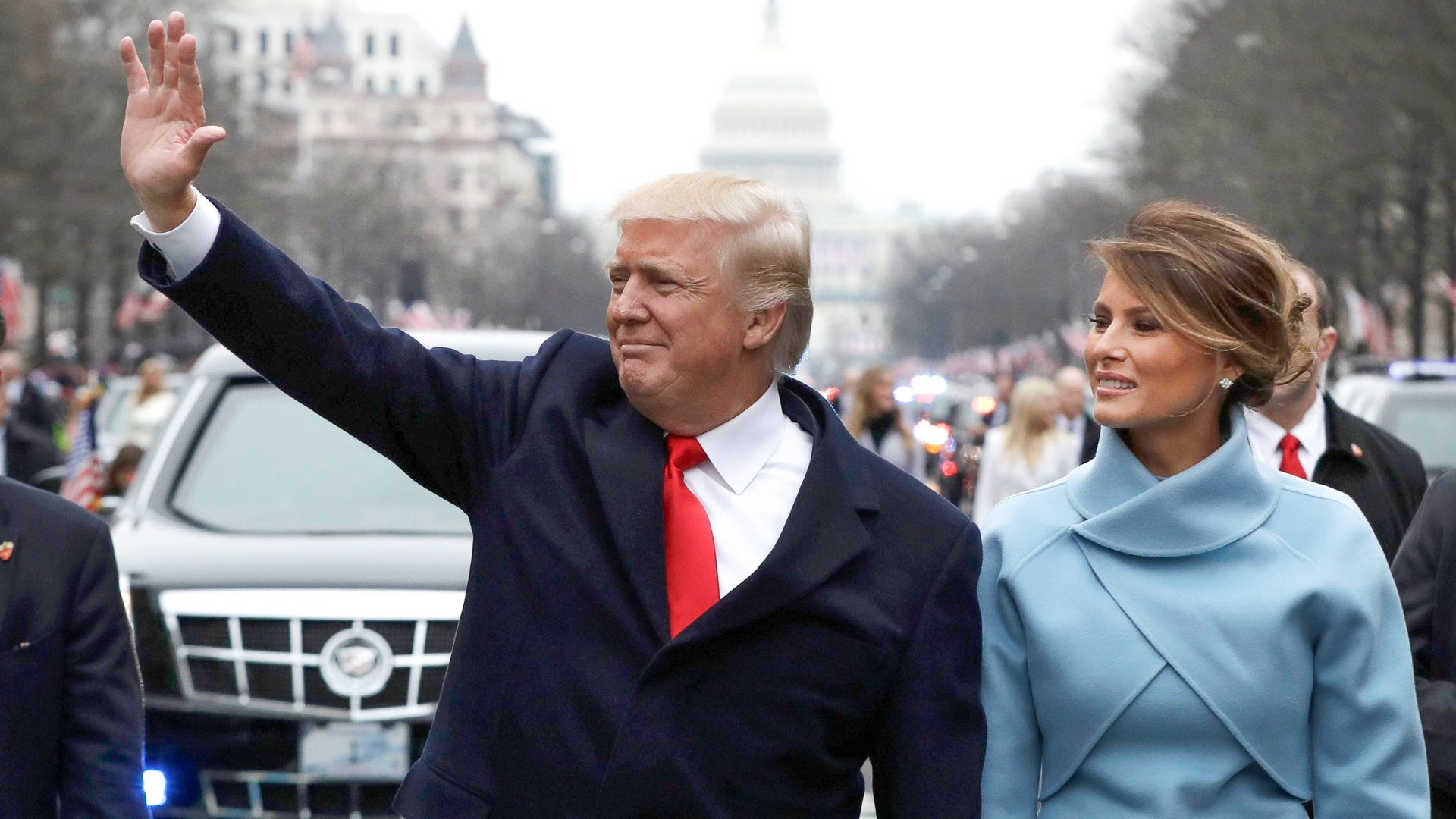President Donald Trump waves with Melania Trump