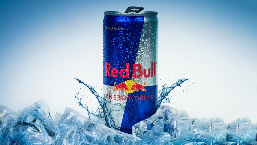 Trieste, Italy - May 29, 2016:  Aluminium can of Red Bull Energy drink iced Background.