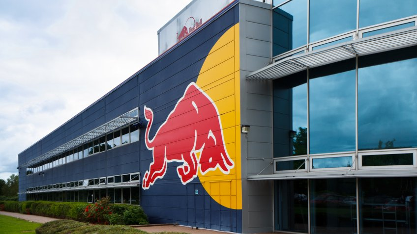 Milton Keynes, UK - July 9, 2012: Red Bull Racing factory/headquaters building with their typical logo painted on the side.