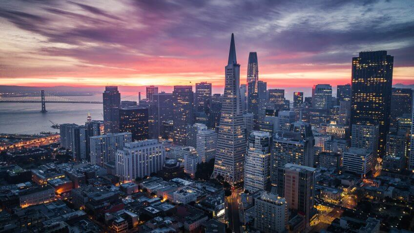 San Francisco Skyline with Dramatic Clouds at Sunrise, California, USA.
