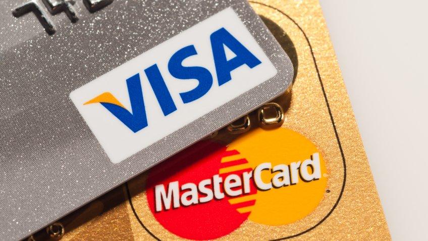 Caracas, Venezuela - July 22, 2011: Visa and Mastercard logos on platinum and golden credit cards.