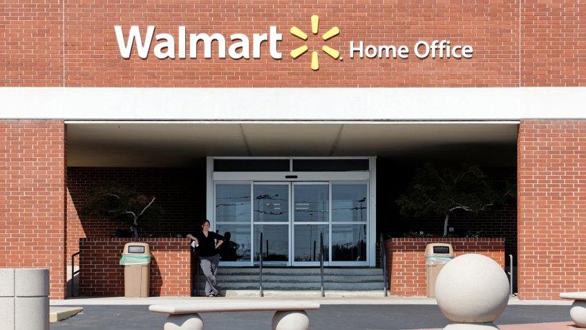 Bentonville, Arkansas, USA – October 4, 2012: An employee stands near the entrance to the Walmart Home Office in Bentonville.