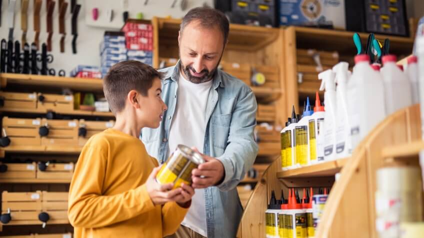 Photo of father and son in hardware store.