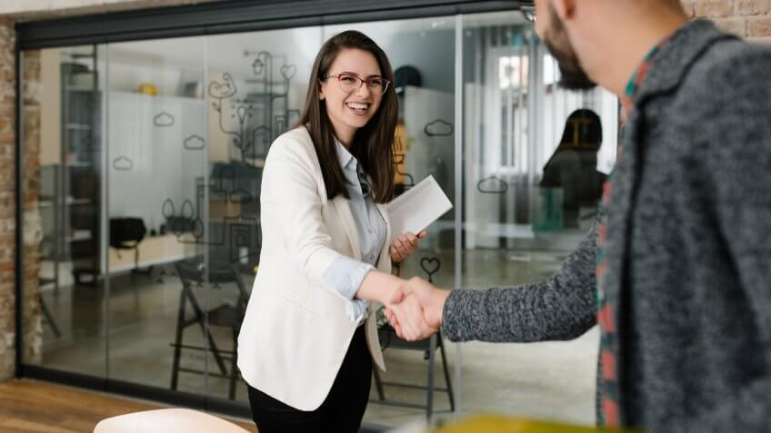 female recruiter shaking hands with interviewee