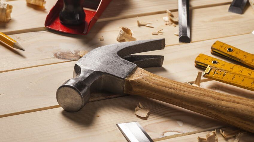 hammer and other hardware tools on wooden deck