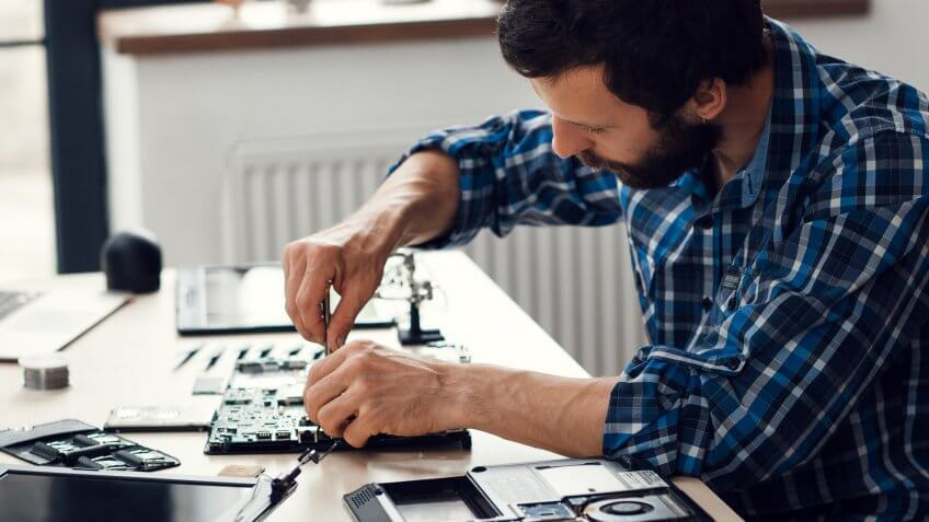man refurbishing computer product