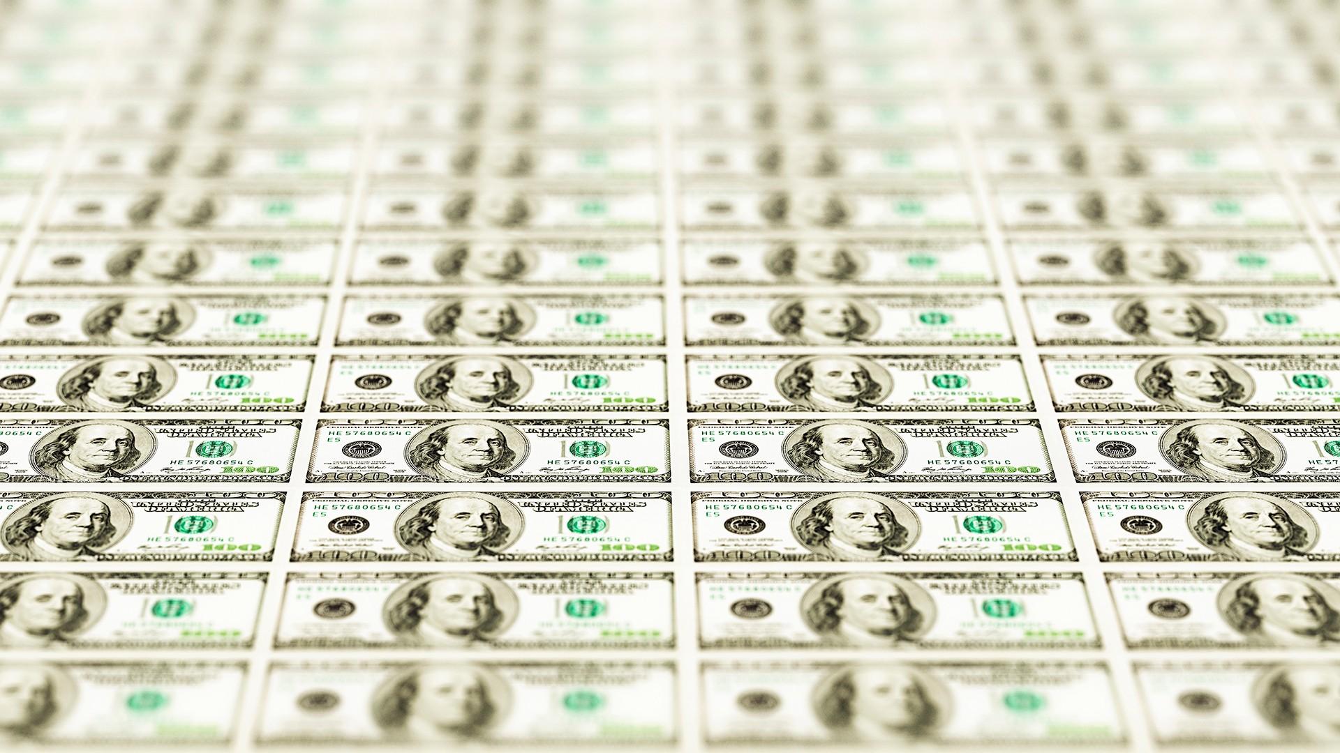 Perspective shot of hundreds of US hundred dollar bills.