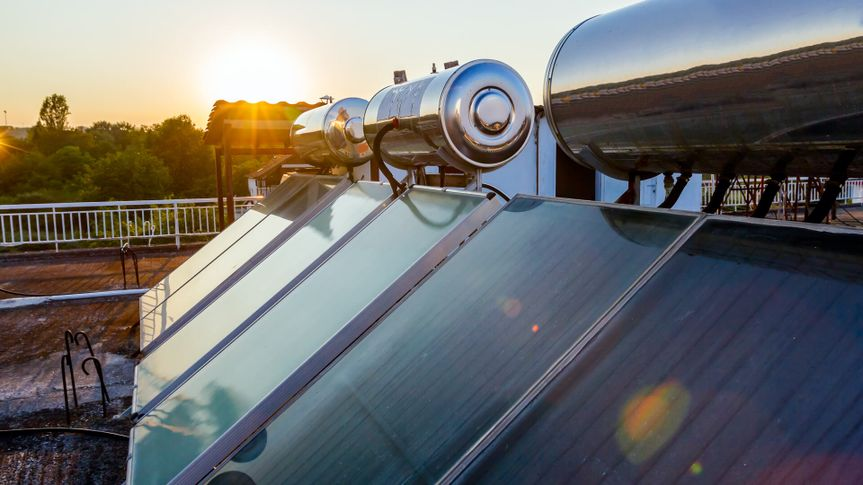 Water panels for using renewable sun energy are placed on house roof, solar hot water system.