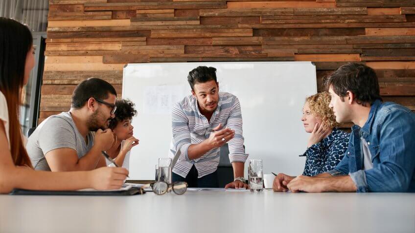 Brainstorming in a boardroom of creative office .