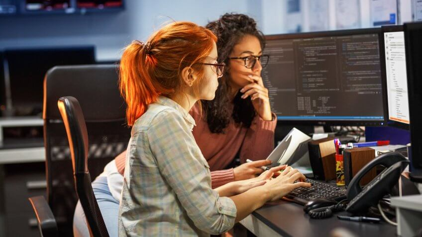 Two female programmers working on new project.