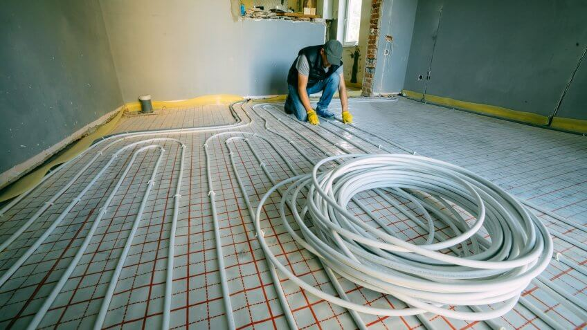 Pipefitter installing system of heating.