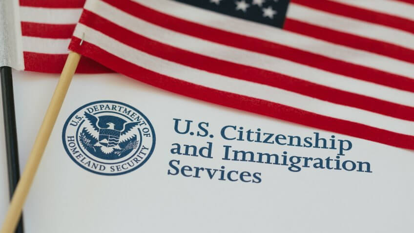 US flag and citizenship and immigration paperwork.