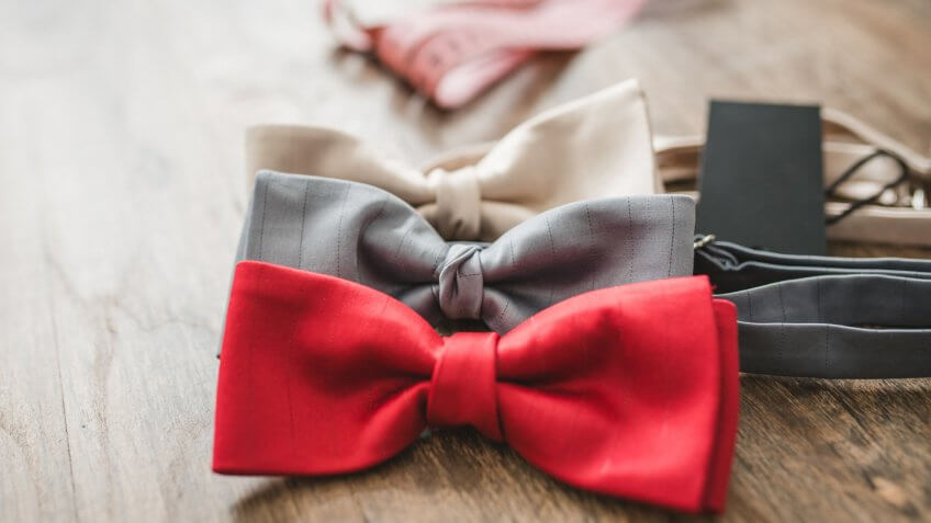 Bow ties on table in tailor shop.