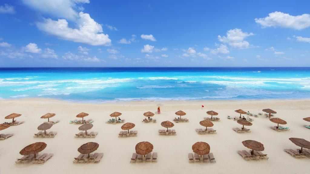 Tropical beach resort in Cancun, Mexico on a beautiful spring break day.