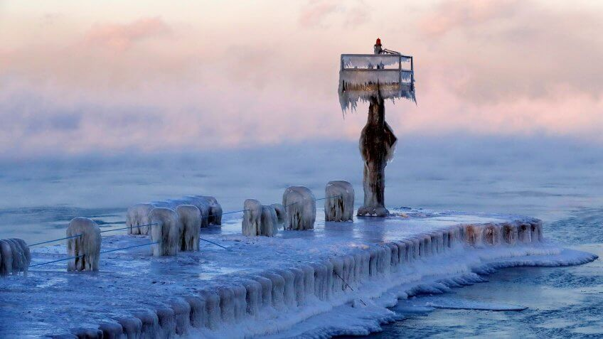 A harbor light is covered by snow and ice on the Lake Michigan at 39th Street Harbor, in Chicago
