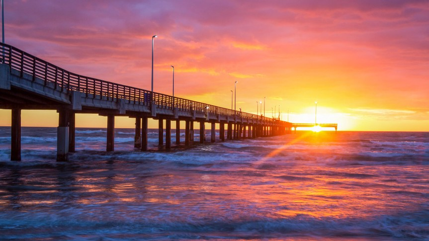 Corpus Christi Texas beach with pier at sunset