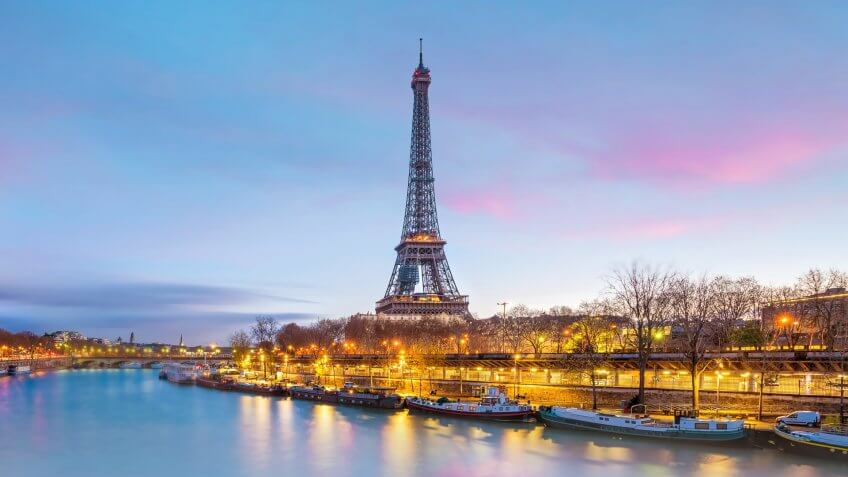 The Eiffel Tower and river Seine at twilight in Paris, France.