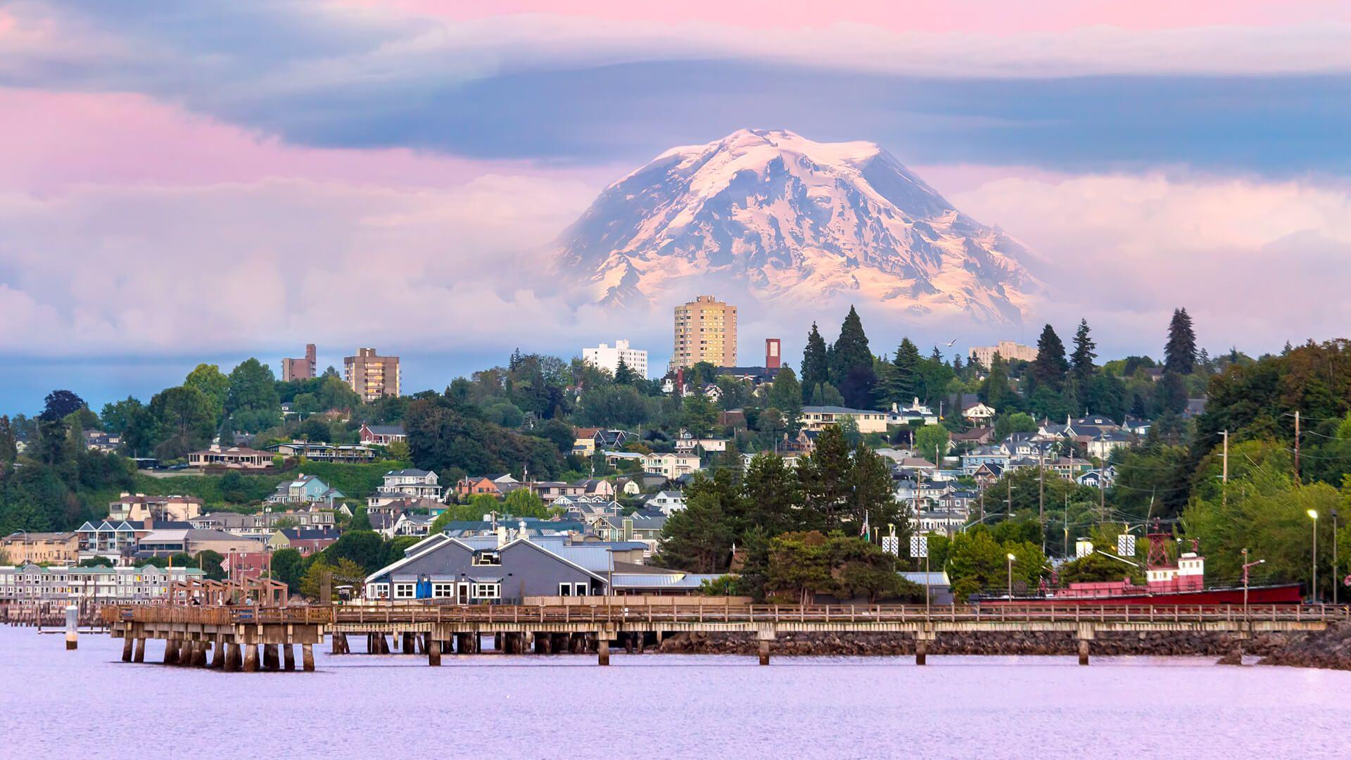 Mount Rainier over Tacoma Washington waterfront during alpenglow sunset evening.