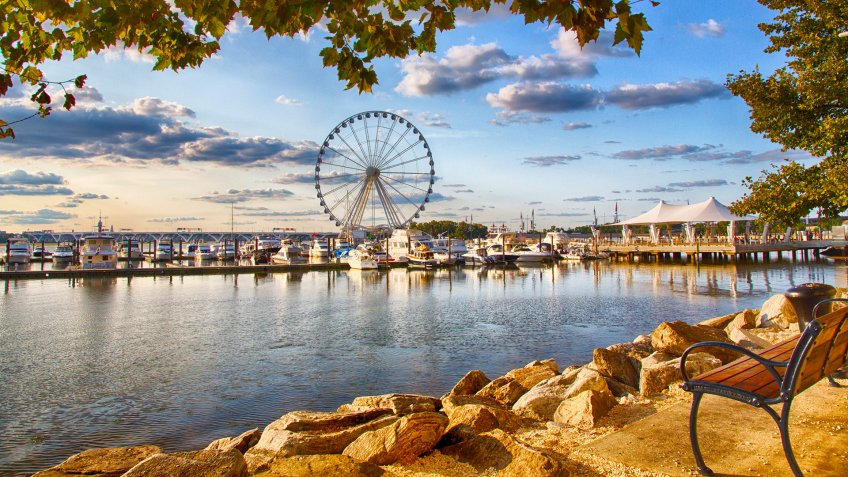 September 10, 2017, Oxen Hill, Maryland, USA: Boats dcked on the national waterfront sit in front of the pier and ferris wheeel in late summer.