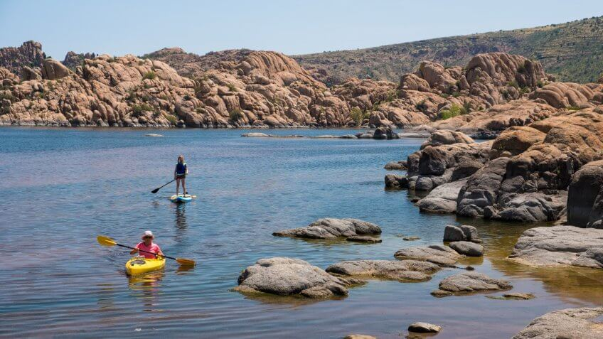 Two women enjoying water activities at Watson Lake nearby Prescott, AZ.