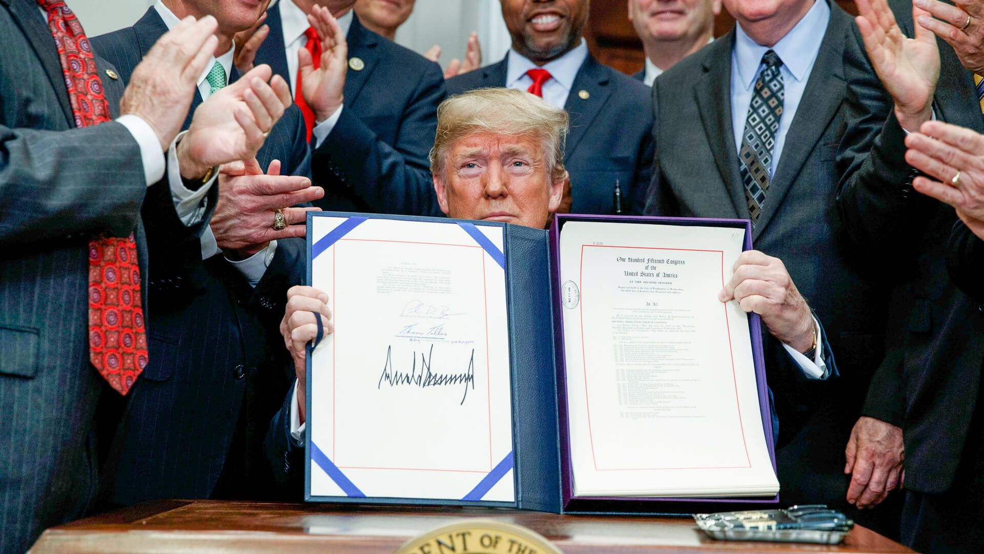 President Donald Trump signs the Economic Growth Regulation Relief and Consumer Protection Act