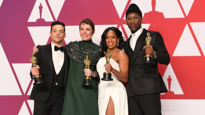 Rami Malek, Olivia Colman, Regina King, and Mahershala Ali hold their 2018 Oscar award statues