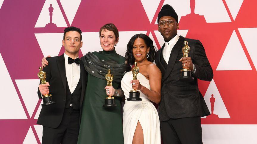 Rami Malek, Olivia Colman, Regina King, and Mahershala Ali hold their 2018 Oscar award statues