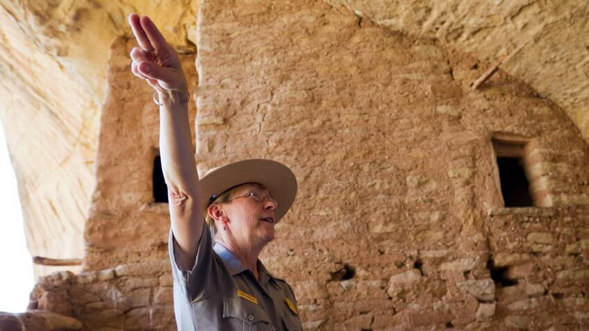 National Park ranger pointing figures in direction
