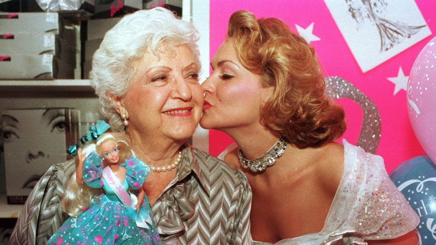 Mandatory Credit: Photo by Robert Clark/AP/REX/Shutterstock (6538610a)RUTH HANDLER Barbie doll creator Ruth Handler, left, gets a kiss from Kristi Cooke, an actress dressed as a Barbie doll, during the 35th birthday celebration for the doll at FAO Schwarz in New York City onBARBIE CREATOR RUTH HANDLER, NEW YORK, USA.