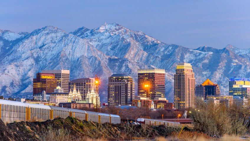 Salt lake City downtown and snow capped mountain.
