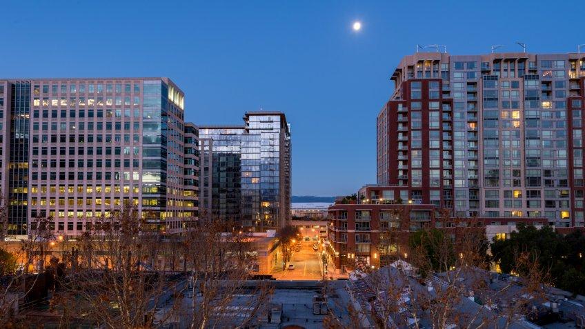 A full moon hangs over San Jose.