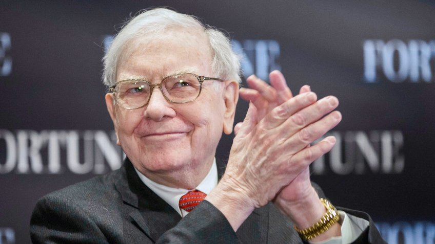 Warren Buffett claps his hands during interview