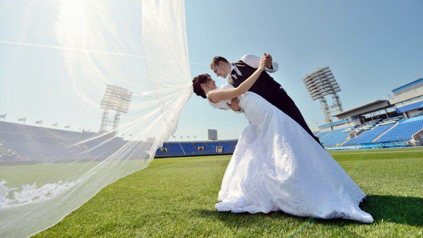 Wedding couple at a football stadium