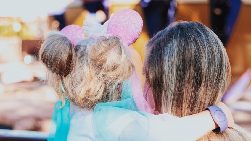 Young child with princess Minnie mouse ears