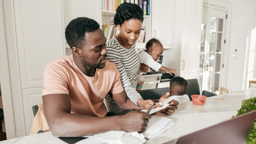 african american couple budgeting together in their house