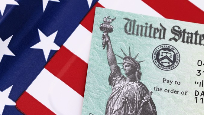 IRS tax refund check on a stars and stripes background.