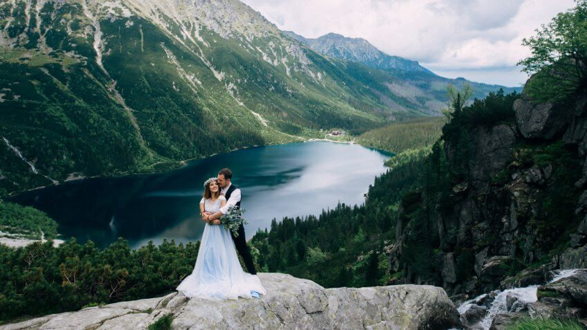 bride and groom wedding with a mountain view
