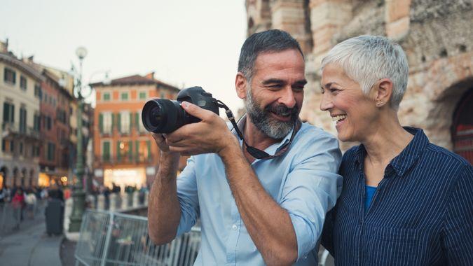 Mature couple as tourist in city Verona.