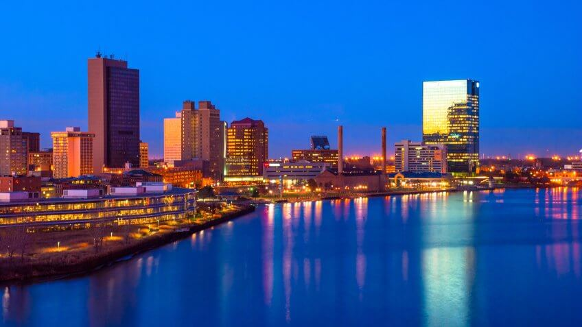 Downtown Toledo skyline and Maumee River aerial / elevated view at dusk with sunset reflections.
