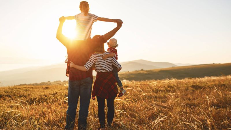 Happy family: mother, father, children son and  daughter on nature  on sunset.