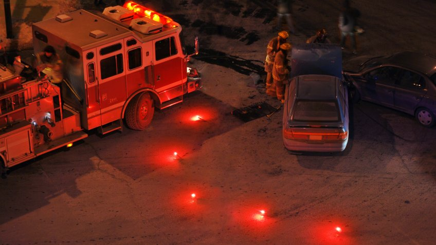 Fender bender and fire engine at night