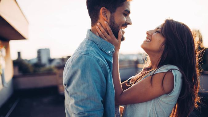 Beautiful young couple in love dating outdoors and smiling.