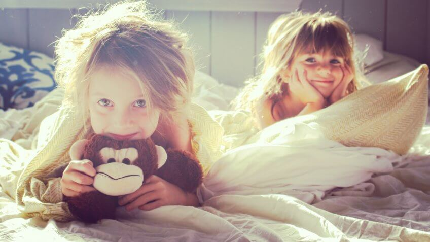 Two little girls in the early morning light.
