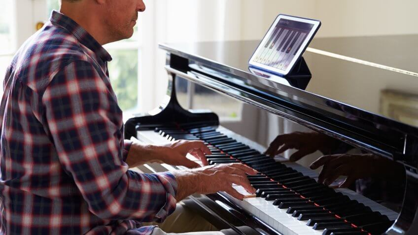 man playing the piano at home