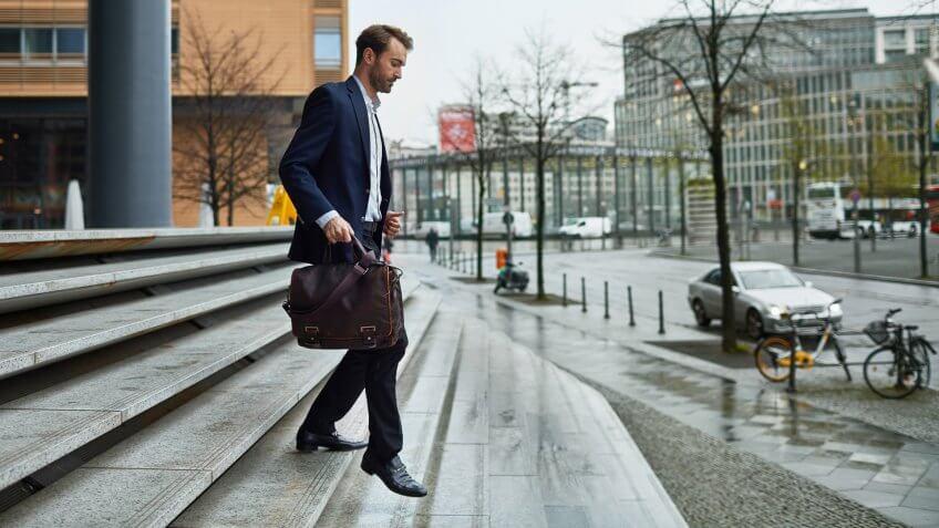 Mid adult men leaving work back home.