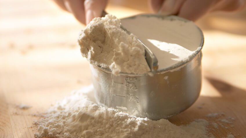 Baking - measuring flour.