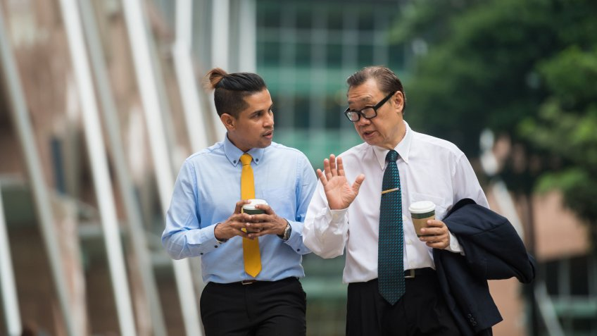 Senior businessman mentoring a colleague.