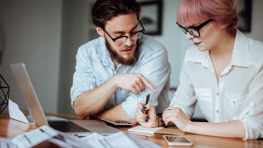 millennial couple figuring out finances